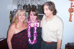 Daughter standing between her parents.