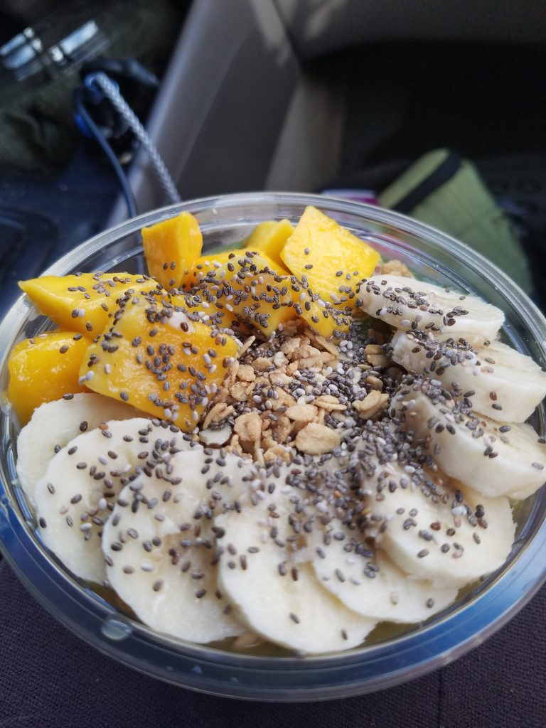 Green Smoothie bowl topped with bananas, mango and chia seeds.