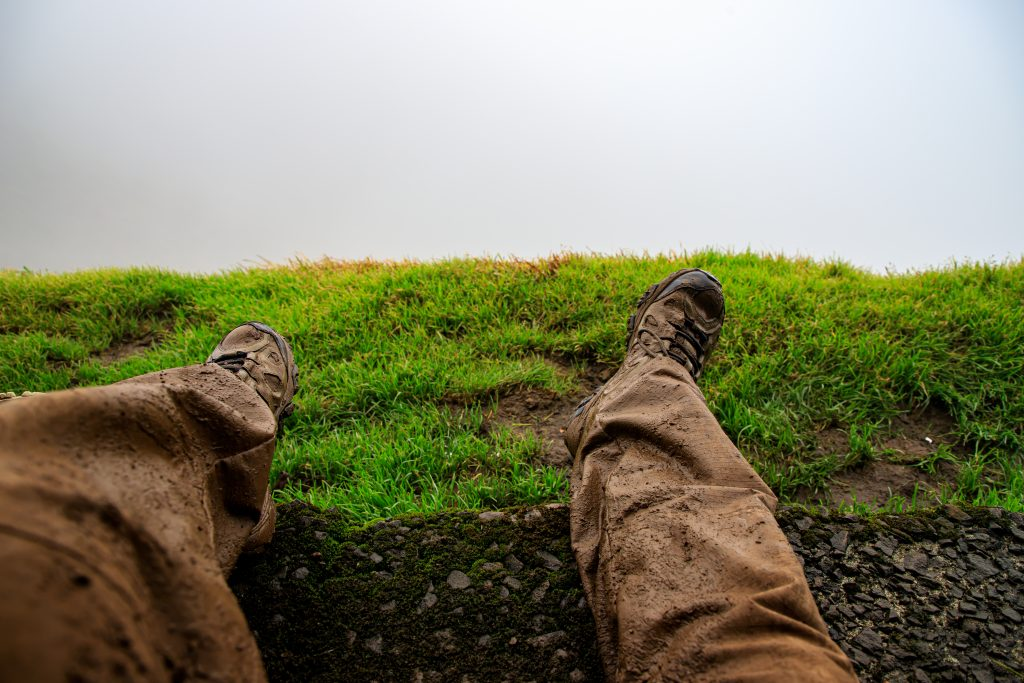 Muddy boots looking out over clouds