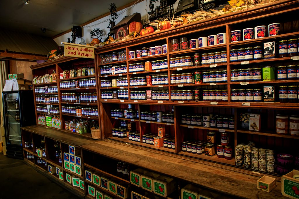 Shelves full of jams, butters and other jar food.