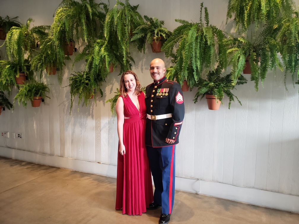 Couple in front of a fern wall at The MODERN Honolulu in Hawaii at a USMC Ball