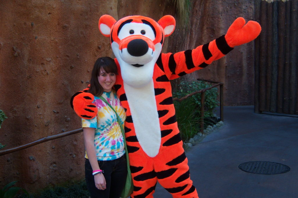 Girl standing with Tiger from Winnie the Pooh