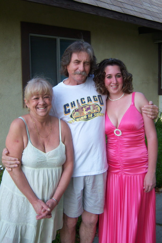 Mother, Father, and Daughter before prom