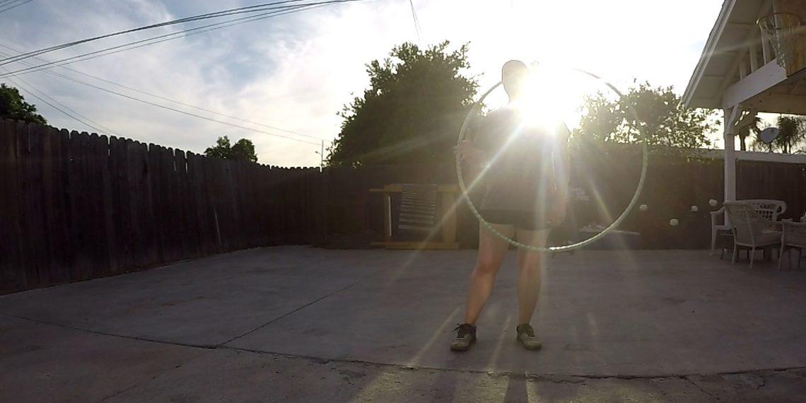 Silhouette of a girl hula hooping