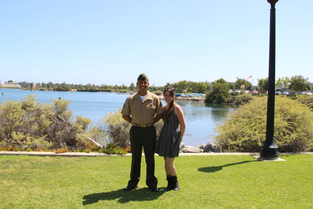 Marine and girl in front of a lake