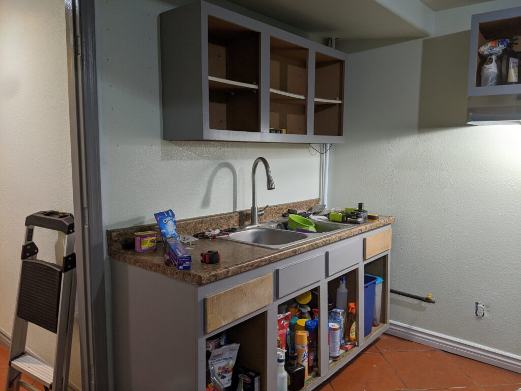 Partially finished kitchen cabinets without doors