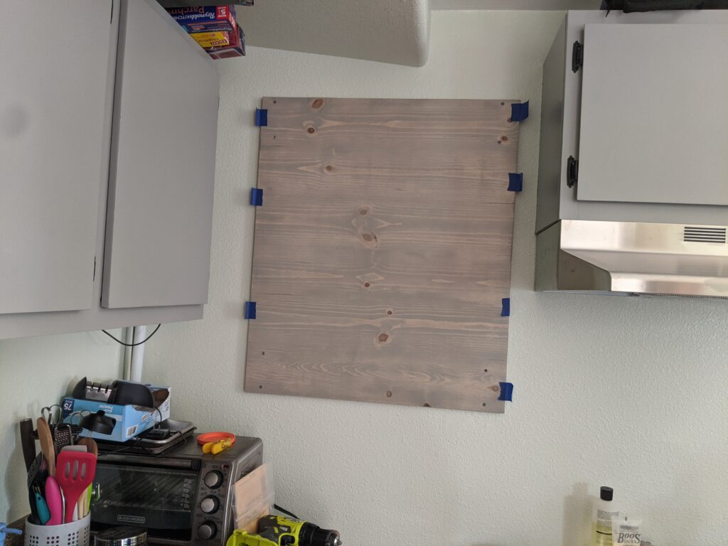 Handmade wooden panel mounted on a kitchen wall